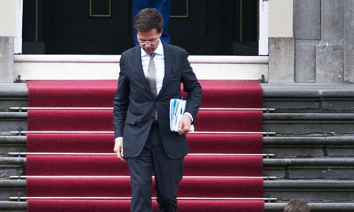 Dutch Prime Minister Mark Rutte leaves after submitting his government's resignation to Queen Beatrix at the royal palace, in the Hague, on April 23. (AFP/Getty Images)