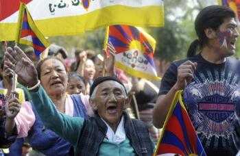 Citizens of Tibet protest the retirement of the Dalai Lama, who announced ten days ago his retirement from political power. (Raveendran/AFP/Getty Images)