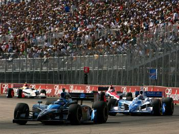 Danica Patrick leads Tony Kanaan during the IRL IndyCar Series Rexall Edmonton Indy.  (Darrell Ingham/Getty Images)