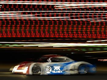 Dario Franchitti leads the Grand Am Rolex 24 in the  #02 Telmex Ganassi Riley BMW after a night of fog and yellow flags. (John Harrelson/Getty Images)