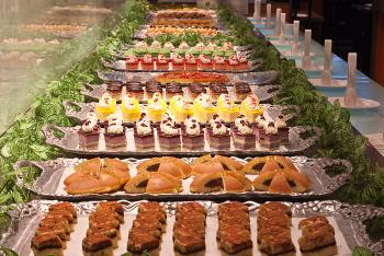 A row of moist cakes, chocolates, and other sweets line the dessert buffet at Ichi Umi. (Joshua Philipp/The Epoch Times)
