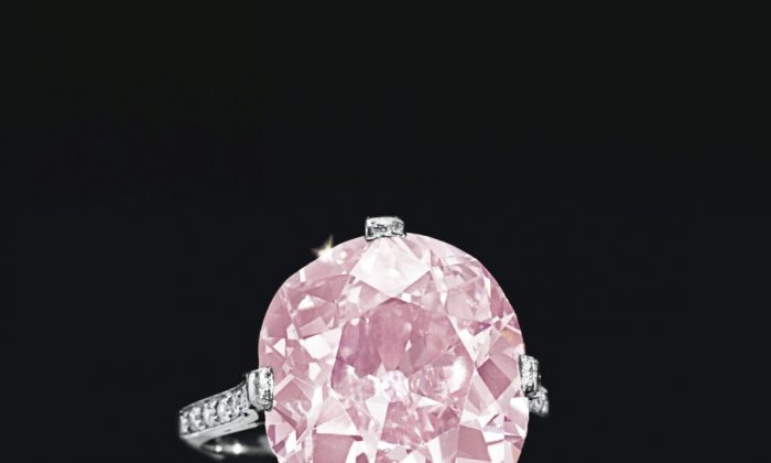 The fancy vivid purplish pink diamond ring, weighing 9.00 carats, mounted in platinum By Dreicer & Co. (1910), that sold for $15.7 million at Christie's. (Courtesy of Christie's)