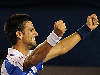 Novak Djokovic exults after winning his men's singles final match against Andy Murray at the Australian Open tennis tournament. (Nicolas Asfouri/AFP/Getty Images)