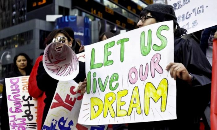Immigrant youths show support for the DREAM Act at a rally in Times Square in November 2010. (Phoebe Zheng/The Epoch Times)