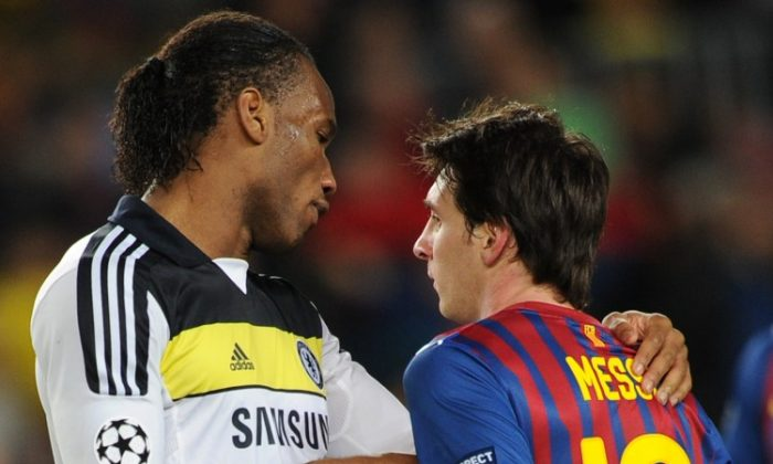 Chelsea's Didier Drogba shakes hands with Barcelona's Lionel Messi after Tuesday's Champions League semifinal second leg match. (Lluis Gene/AFP/Getty Images)