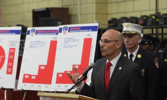 Fire Commissioner Salvatore J. Cassano announced a record setting number of applicants for the firefighters exam, which was given between March 15 and April 20, at the quarters of Engine 37 and Ladder 40 in Harlem on Tuesday.(Gary Du/The Epoch Times)