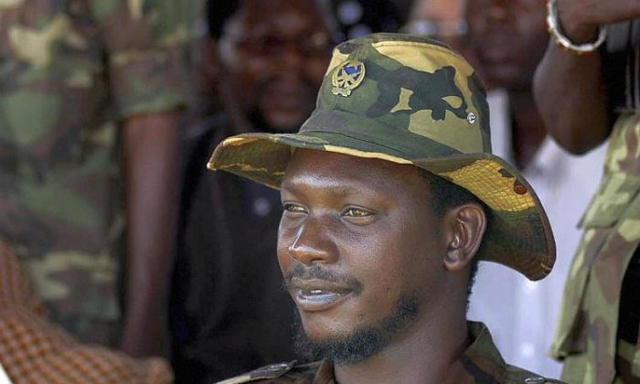 Congolese militia leader Thomas Lubanga Dyilo is seen at a rally in Bunia, DR Congo, on June 3, 2003. Lubanga was found guilty of conscripting and enlisting child soldiers by the International Criminal Court on March 14. (Gianluigi Guercia/AFP/Getty Images)