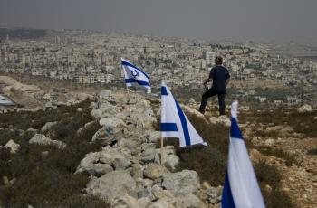 A resident of the settlement Efrat stands on a disputed hilltop next to Efrat that overlooks Bethlehem. (Genevieve Long/The Epoch Times)