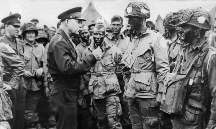 Picture of supreme commander for the 1944 cross-channel invasion of the continental mainland, general Dwight D. Eisenhower giving order of the day to the paratroopers, just before they board their airplane to participate in the first assault in the invasion of the continent of Europe, 06 June 1944, England. (AFP/GettyImages)