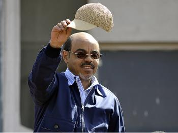 Ethiopian Prime Minister Meles Zenawi waves to supporters at the Meskel Square in Addis Ababa on May 25, to celebrate his landslide election victory. (Simon Maina/AFP/Getty Images)
