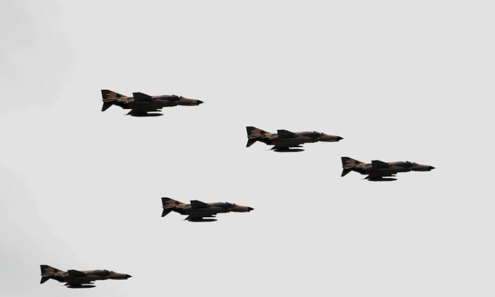 F-4 Phantom fighter jets fly during the Army Day parade in the Iranian capital Tehran on April 18, 2010. (Behrouz Mehri/AFP/Getty Images)