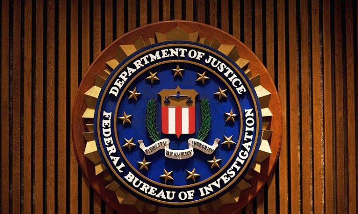 The crest of the Federal Bureau of Investigation is seen in this file photo inside the J. Edgar Hoover FBI Building in Washington. (Mandel Ngan/AFP/Getty Images)