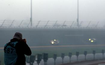 A photographer tries to work through the early morning fog during the Rolex 24 at Daytona International Speedway. (Sam Greenwood/Getty Images)