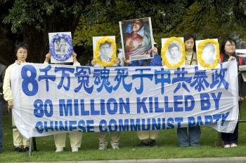 Protesters wait outside Parilament buildings for arrival of Chinese Premier Wen Jiabao at on April 6, 2006 in Wellington, New Zealand. The recent U.S.-China human rights dialogue presents an opportunity to reflect on human rights in China, in the context of country's rise. (Marty Melville/Getty Images)