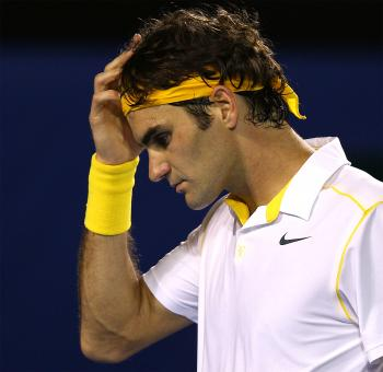 Roger Federer reacts in his semifinal match against Novak Djokovic. (Mark Dadswell/Getty Images)