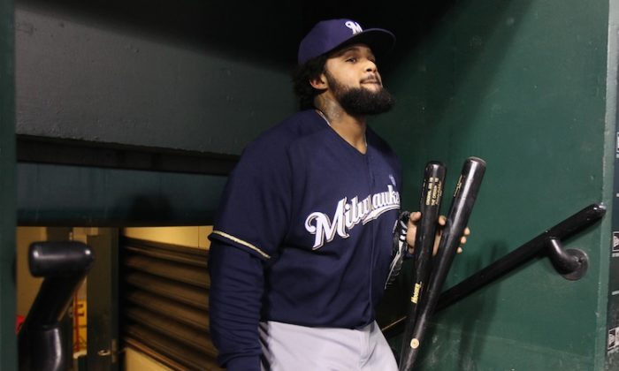Prince Fielder will be taking his bat to Detroit in 2012. (Christian Petersen/Getty Images)