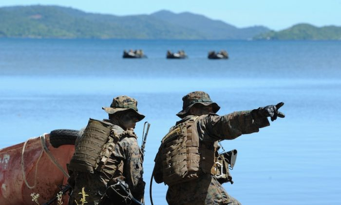 US soldiers are seen during a joint mock beachfront assault on the shore of Ulugan Bay on Palawan island on April 25. US and Filipino soldiers stormed the South China Sea island in war games that took place not far from a real-life maritime standoff between Manila and Beijing. (Ted Aljibe/AFP/Getty Images)