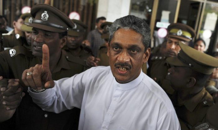 Sri Lanka's jailed ex-army chief and opposition leader Sarath Fonseka gestures as he arrives at the Court of Colombo, Jan. 25. (Ishara S. Kodikara/AFP/GettyImages)