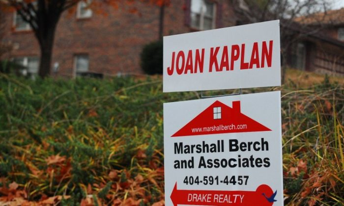 A for sale sign in Atlanta, Ga., on Nov. 27. The mortgage interest deduction costs the government about $100 billion each year, according to the Brookings Institution. (Mary Silver/The Epoch Times)