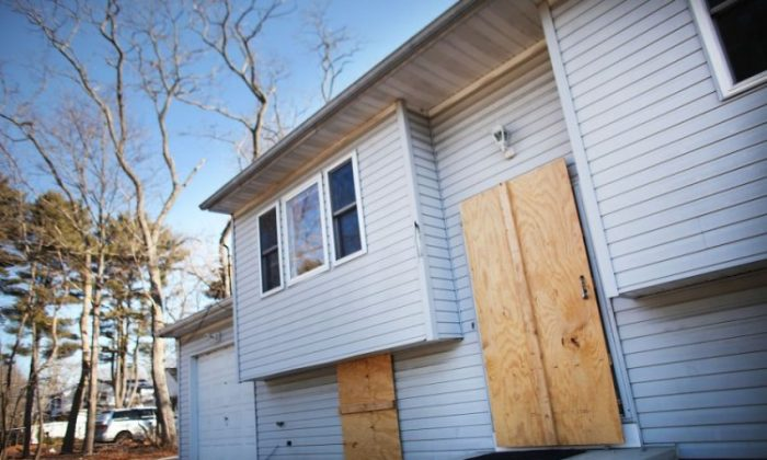 The United States saw a peak in foreclosed homes, like this one in Islip, N.Y., in 2010. But experts suggest that the number of foreclosures will rise again in 2012. (Spencer Platt/Getty Images)