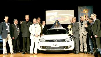 The Golf VI, Volkswagen's most popular seller around the world, won the 2009 World Car of the Year Award at the NY International Auto Show held at the Jacob Javits Center this week. VW CEO Stefan Jacoby stands to the right of the car holding winning trophy. (Edward Dai/The Epoch Times)