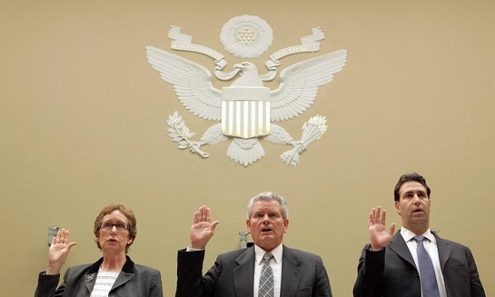 (L-R) Former Government Services Administration chief Martha Johnson, GSA regional commissioner Jeff Neely, and GSA chief of staff Michael Robertson, are sworn in before testifying to the House Oversight & Government Reform Committee on Capitol Hill, April 16. Neely invoked the Fifth Amendment when asked to testify.(Chip Somodevilla/Getty Images)