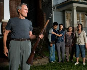 NEIGHBORS:(L-R) Walt Kowalski (Clint Eastwood), Thao (Bee Vang), Vu (Brooke Chia Thao), Grandma (Chee Thao) and Sue (Ahney Her) in a scene from the Clint Eastwood directed Gran Torino. (Anthony Michael Rivetti/Warner Bros. Pictures)