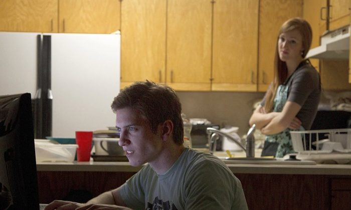 Actors pose for a photograph illustrating marriage problems caused by playing online role-playing games. (Brigham Young University)
