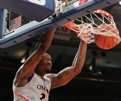 Cincinnati will be counting on a big game from Yancy Gates (dunking) to upend Ohio State. (Jim McIsaac/Getty Images)