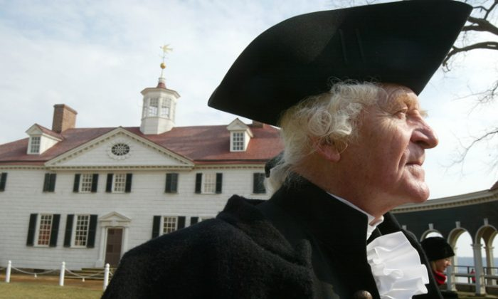 Dressed as founding father George Washington, William Sommerfield waits to greet visitors outside a mansion in Mount Vernon, Va. According to historians, Washington's importance has waned in recent decades, but a library being built at Mount Vernon aims to spark new interest. (Alex Wong/Getty Images)