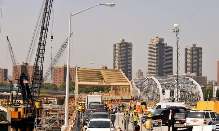 Crews install the new Willis Avenue Bridge (L) as it's placed into its permanent position over the Harlem River August 9, 2010 in New York City. The 350-foot long pre-fabricated span replaced the 109 year-old swing bridge previously in use. (Stephen Chernin/Getty Images)