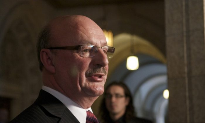 Labour critic Yvon Godin criticized Labour Minister Lisa Raitt's back-to-work legislation in a scrum with reporters on Parliament Hill Monday. Godin said the legislation is an infringement on the rights of workers and Air Canada. (Matthew Little/The Epoch Times)