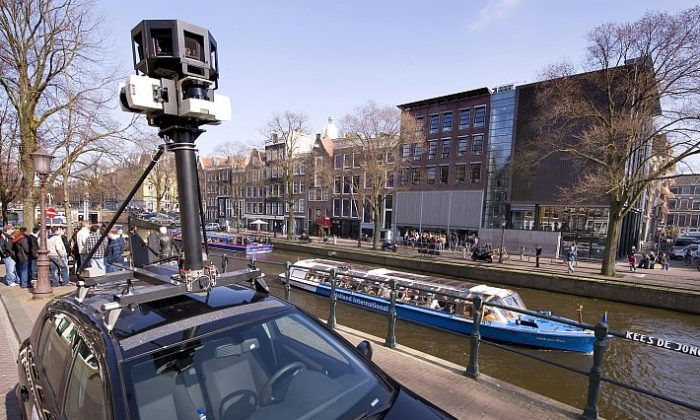 A Google Street View camera fastened on top of a car in Amsterdam is seen in this file photo. Google has recently been fined $25,000 by the FCC for gathering data from private Wi-Fi networks around the world. The advocacy group Electronic Privacy Information Center (EPIC) wants the Justice Department to investigate further. (Toussaint Kluiters/AFP/Getty Images)