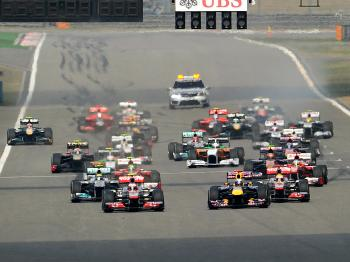 Button and Hamilton got the jump on Vettel at the start. (Liu Jin/AFP/Getty Images)