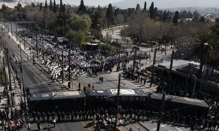 Police block public access to roads on Greek Independence Day in Athens on March 24. Fears of anti-austerity protests prompted an unprecedented security mobilization. (Angelos Tzortzinis /AFP/Getty Images)