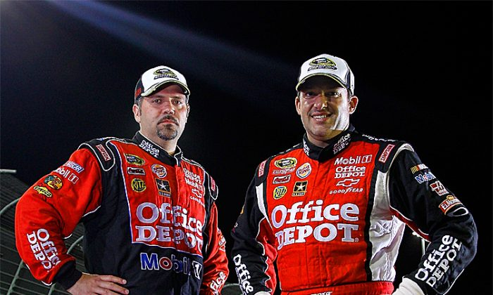 Tony Stewart (R) and crew chief Darian Grubb (L) pose with the championship trophy after winning the NASCAR Sprint Cup Ford 400 and the 2011 Series Championship. (Chris Graythen/Getty Images)