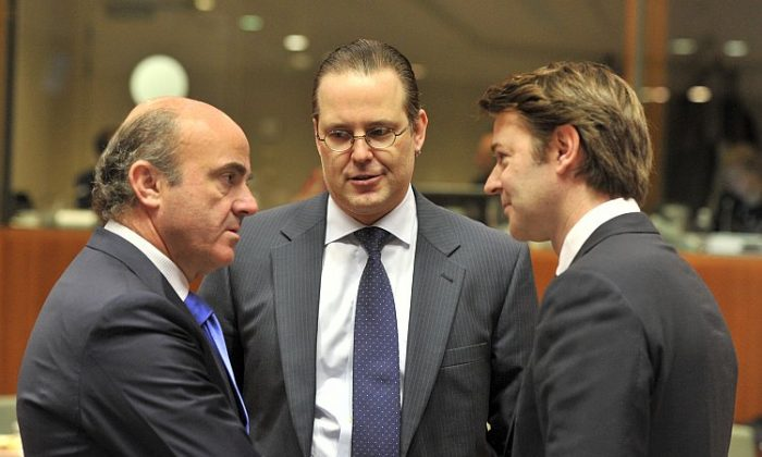(L to R) Spanish Finance Minister Luis De Guindos, Swedish Finance Minister Anders Borg, and French Finance Minister François Baroin talk prior an ECOFIN Council on March 13, at the EU Headquarters in Brussels. (Georges Gobet/AFP/Getty Images)