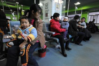 Patients waiting for H1N1 treatment in a hospital in China's Anhui province on Jan. 8, 2010. (STR/AFP/Getty Images)
