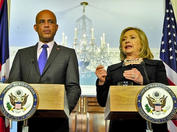 Haiti's new president-elect Michel Martelly giving a joint press conference with Secretary of State Hillary Clinton on April 19. (Jewel Samad/Getty Images)