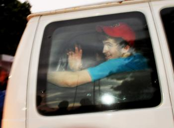 One of the American missionaries held in Haiti on charges of kidnapping children in the wake of last month's massive earthquake waves from the back seat of a van after they were released from jail on Feb. 17, and driven to the airport. Eight of the 10 Ame (Roberto Schmidt/AFP/Getty Images)