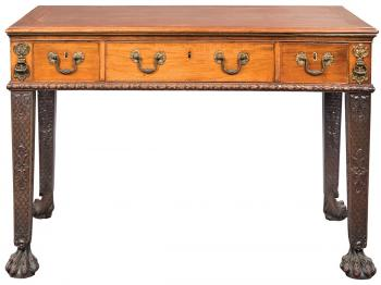 HANDSOME: This late 18th century library table from the estate of a gentleman is handsome and practical. The George III gilt-bronze mahogany desk is estimated at $10,000 to $15,000. (Courtesy of Doyle's New York)