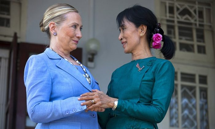 Burma's democracy leader and newly elected Parliamentarian Aung San Suu Kyi meets U.S. Secretary of State Hillary Clinton on Dec. 2, 2011 in Yangon, Burma. Clinton announced this week that the United States will begin to ease some sanctions on Burma in the wake of the election. (Paula Bronstein/Getty Images)