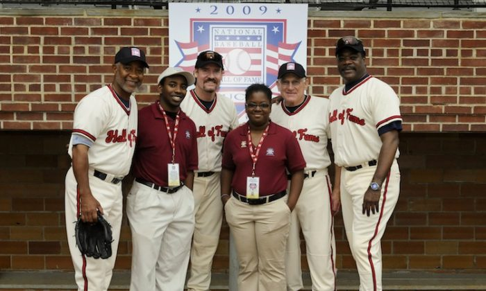 Aisha Johnson and Daniel Sampson, interns in 2009, pose with members of the National Baseball Hall of Fame. Interns spend 10 weeks working in Cooperstown, including for Hall of Fame Weekend. (Milo Stewart Jr./National Baseball Hall of Fame Library)