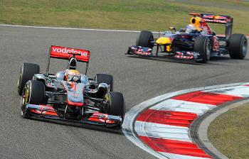 Lewis Hamilton of Britain (L) leads Sebastian Vettel during the Formula One Chinese Grand Prix. (Philippe Lopez/AFP/Getty Images)