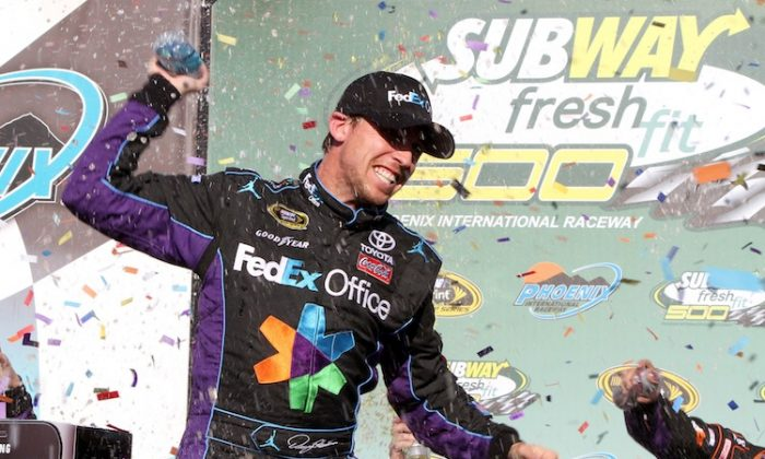 Denny Hamlin, driver of the 11 FedEx Office Toyota, celebrates after winning the NASCAR Sprint Cup Series Subway Fresh Fit 500 at Phoenix International Raceway. (Jerry Markland/Getty Images for NASCAR)