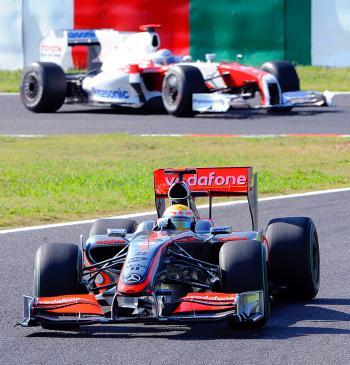 McLaren Mercedes driver Lewis Hamilton leads Toyota's Jarno Trulli during the Japanese Formula One Grand Prix. (Yoshikazu Tsuno/AFP/Getty Images)