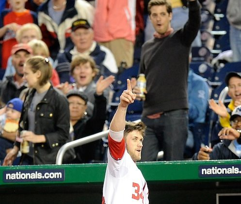 Harper waves to the crowd after hitting his first career home run. (Greg Fiume/Getty Images)