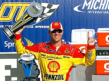 Kevin Harvick, driver of the #29 Richard Childress Racing Shell/Pennzoil Chevrolet, celebrates winning the NASCAR Sprint Cup Series CARFAX 400 at Michigan International Speedway on August 15. (Jason Smith/Getty Images for NASCAR)