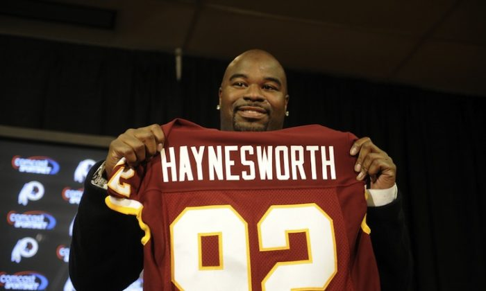 Albert Haynesworth signed a $100 million contract with Washington prior to the 2009 season. (Mitchell Layton/Getty Images)