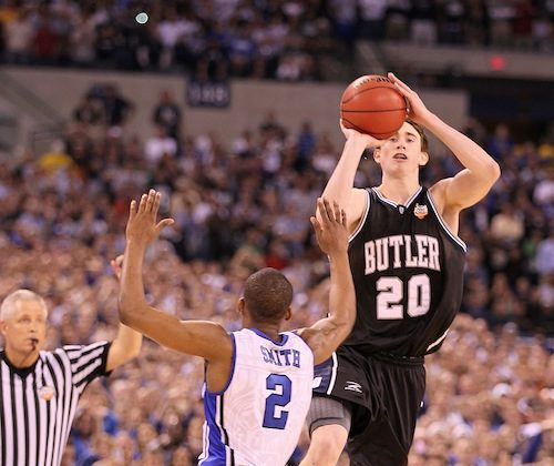 Gordon Hayward's (R) last second half-court shot against Duke rimmed out, ending one of the most improbable tournament run in NCAA history. (Andy Lyons/Getty Images)